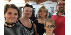 a photo of a family at the art exhibition opening