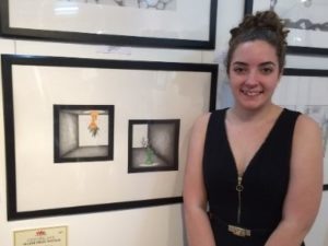 a teenage girl standing beside her major prize winning drawing