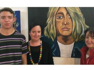 a photo of a teenage boy, his mother and grandmother and his award winning portrait painting