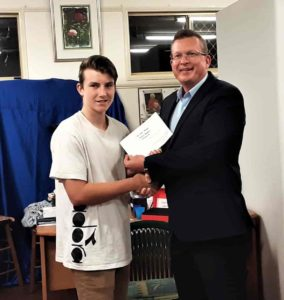 Casey Hooper of Redland College accepts his Major Prize from Opening Speaker Councillor Paul Golle.